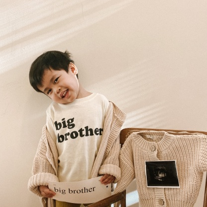 Isn't he the cutest big brother?